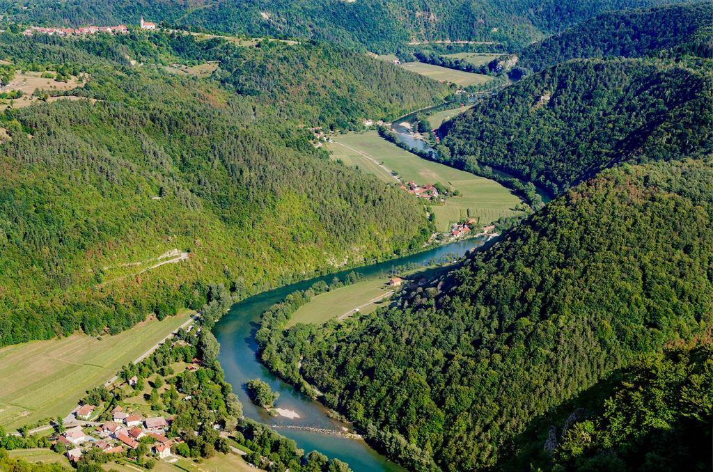 An aerial shot of the Kupa River as it winds through rural Croatia