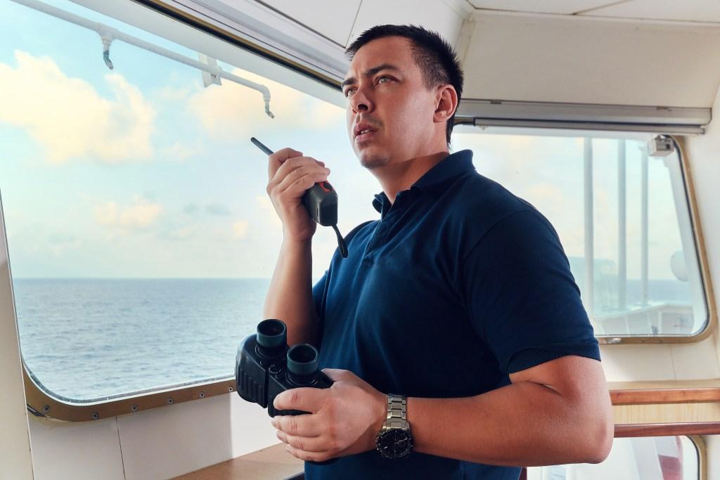 Man talking on boat radio