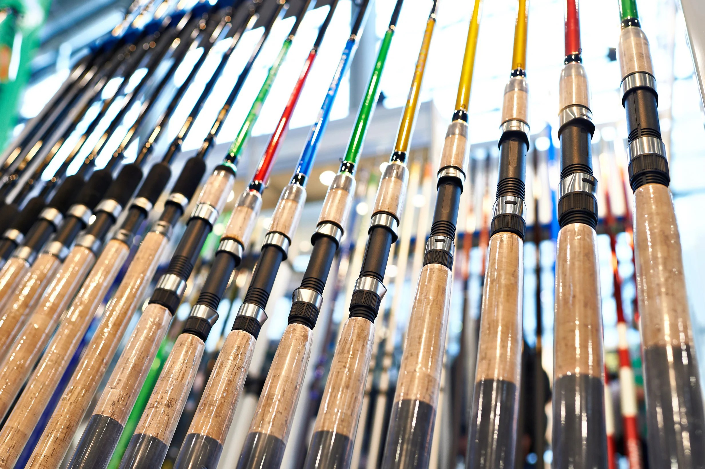 a number of fishing rods racked on a stand