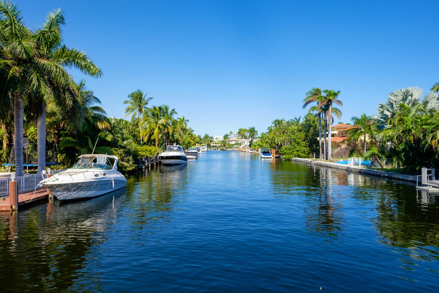 A typical waterfront community in South Florida with docked fishing boats on the water