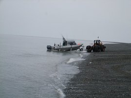 Launching the boat on the beach #3.