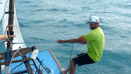 Diomedio, by leaning out he helps balance the boat