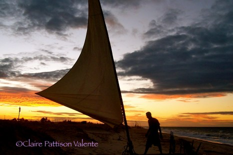 The sail is tested against a spectacular sunset