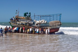 Re-floating boat washed onto the beach
