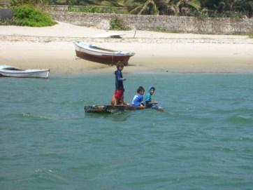 Children fishing the river