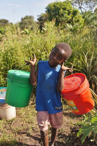 Lenge helping out with bucket transport duty