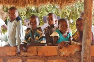 Kids at Mariah and Collin's site peeking through the insaka