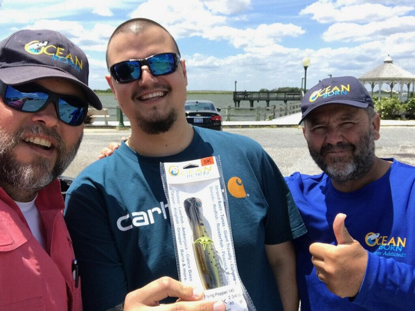 Travis and Patrick from Ocean Born Lures with store staffer Max down the street from the shop at the Ship Bottom Boat Ramp.