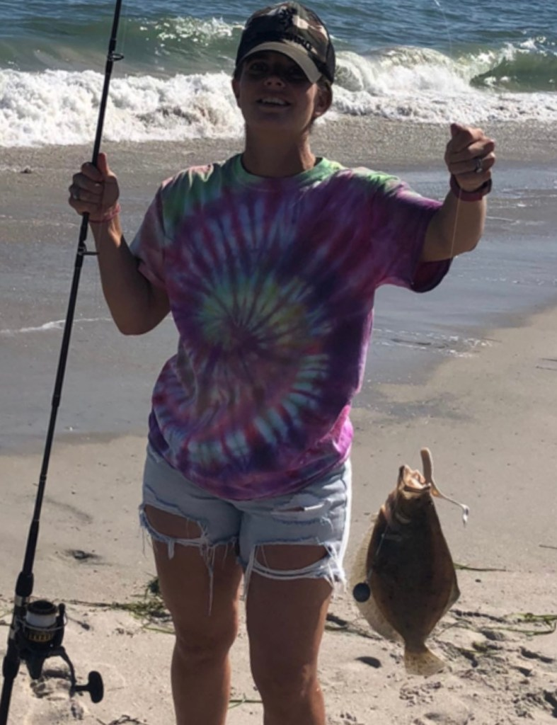 Jaime Grant with an out of season fluke she caught along with some small bluefish.