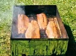Fresh salmon in the hot smoker.