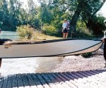 """Two anglers can carry the 12' 6"""" Porta Bote Genesis III down to the water's edge."""