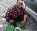 Charles Smith with a good bag of whitebait. Rakaia, whitebaiting. Photograph courtesy of Charles Smith.