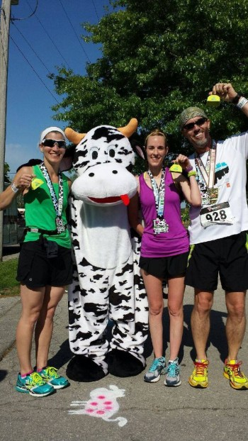 Stacey Ellerman, Sarah Wilson, Don Ledford and an anonymous cow show off the medals (and cowbells) earned at Running With The Cows half marathon on May 10, 2014.
