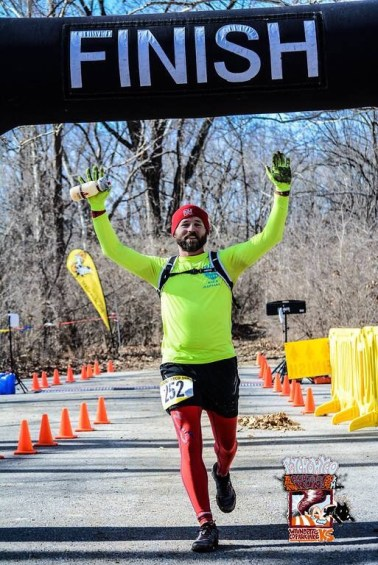 Russell Wenz crosses the finish line
