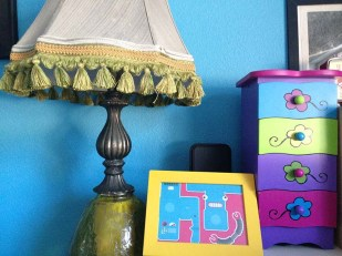 Male's ugly lamp, robot pic and chest of drawers