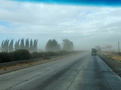 The blustery winds kicked up dust along SR99,