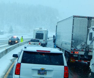 Trooper stopping truck without chains on and making them chain up right on the highway.