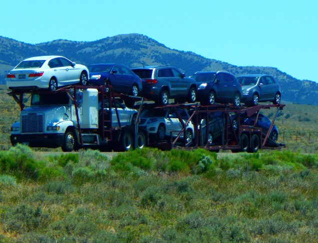 "Nine car ""portable parking lot"". I've never seen more than nine average size cars on a truck. Are there bigger auto transporters?"