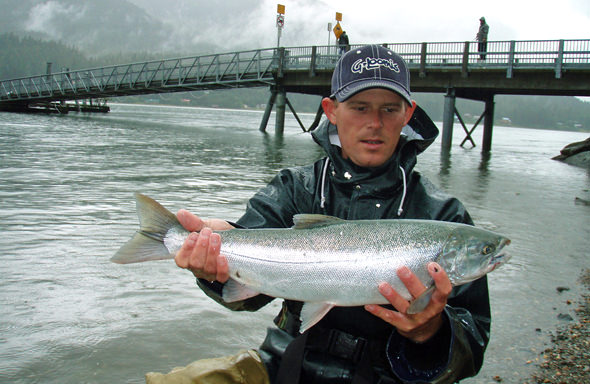Khev with a downtown coho at the DIPAC hatchery