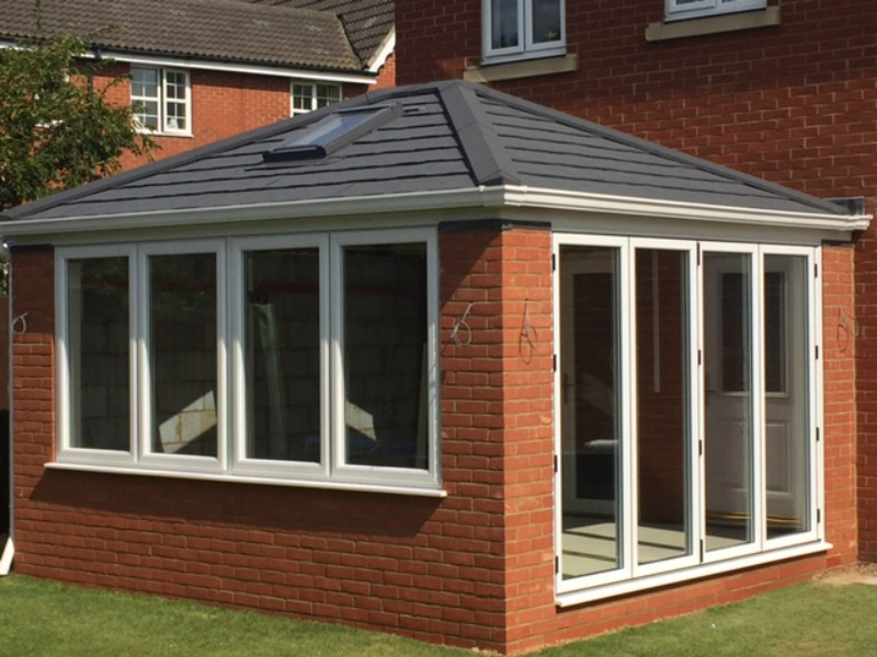 New conservatory with bifold doors  solid warm roof