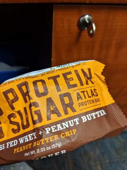 A wrapper for an Atlas Brand peanut butter protein bar