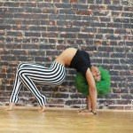 Kyla Back Bend Wheel Striped Pants Green Afro Woman Contortion