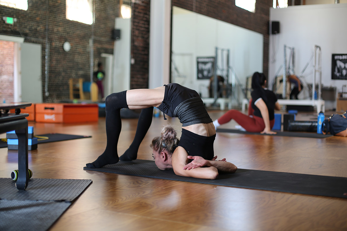Fit and Bendy Avoiding Neck Pressure Chest Stand Woman Contortion Bending Backwards Fitness Studio Flexibility