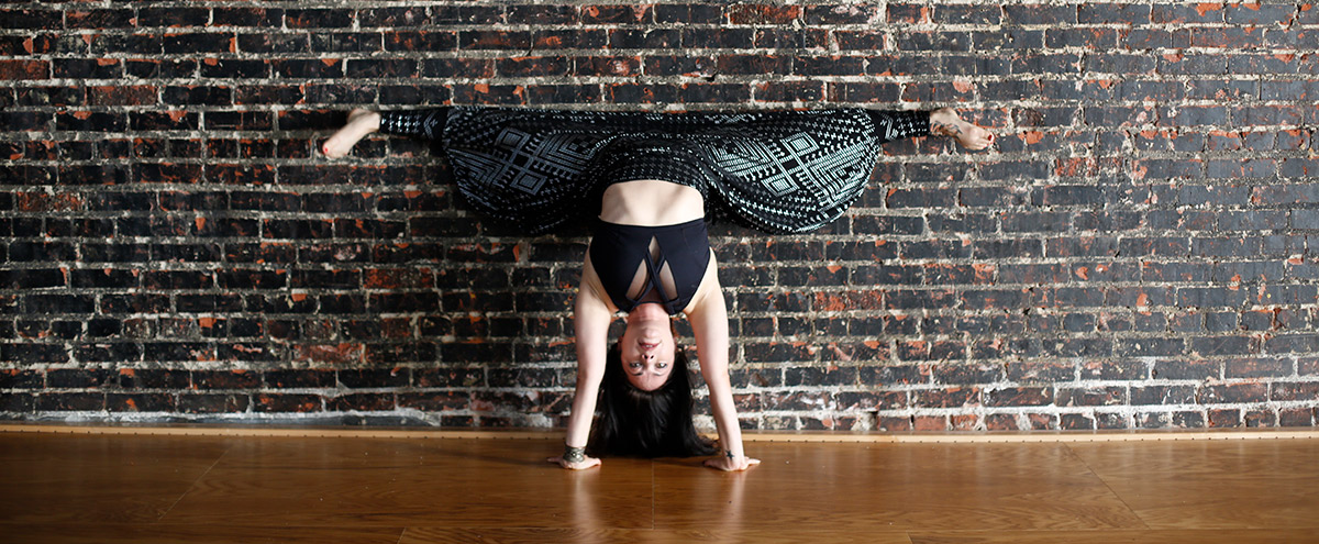 Kristina Nekyia Hand Stand Fit and Bendy Instructor Brick Wall Wood Floor