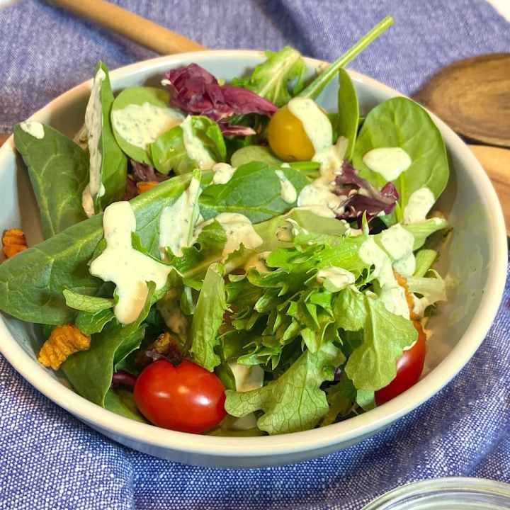 picture of a bowl of leafy greens and tomatoes