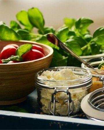 bowl of tomatoes, feta cheese, and fresh basil