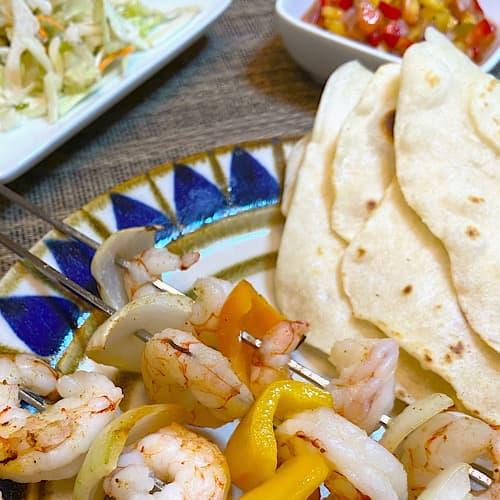 grilled shrimp, homemade tortillas, onions, pepper, and fruit salsa