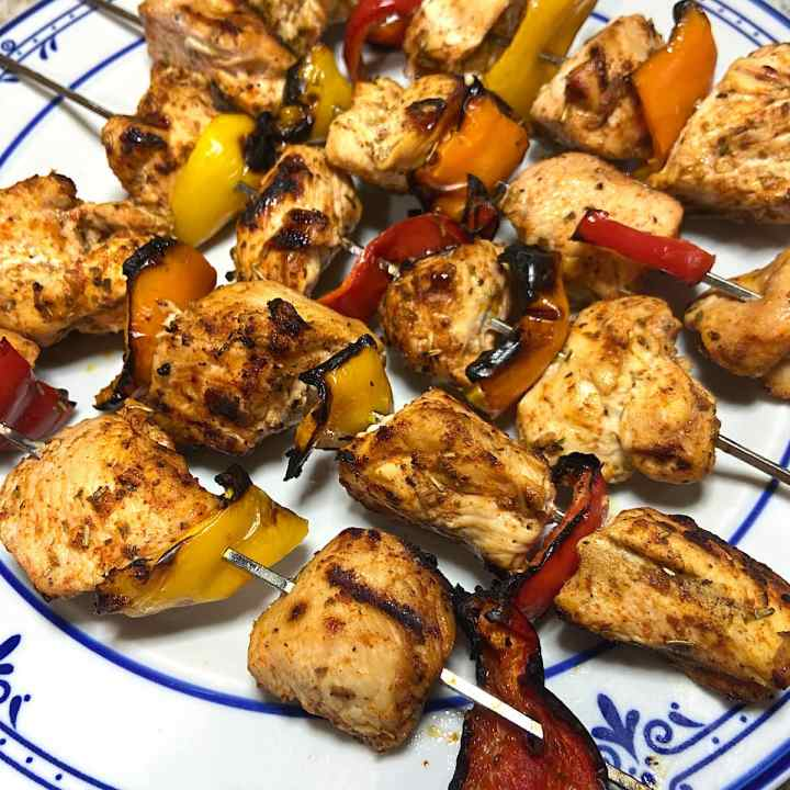 Grilled chicken kabobs on plate ready to eat