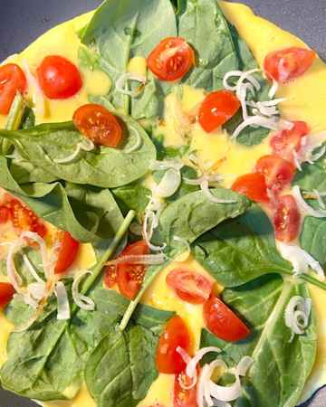 vegetable omelet layered in ingredients