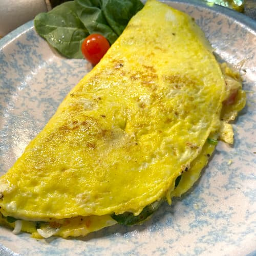 a vegetable omelet is a quick and easy meal.