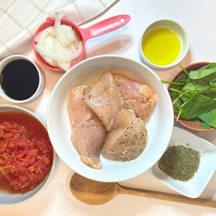 Spread of measured ingredients for balsamic chicken breasts