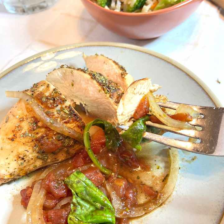 Balasamic chicken breasts combine the flavors of chicken, tomatoes, onion and spices.