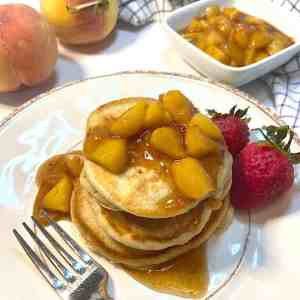 healthy pancakes on plate with fruit sauce