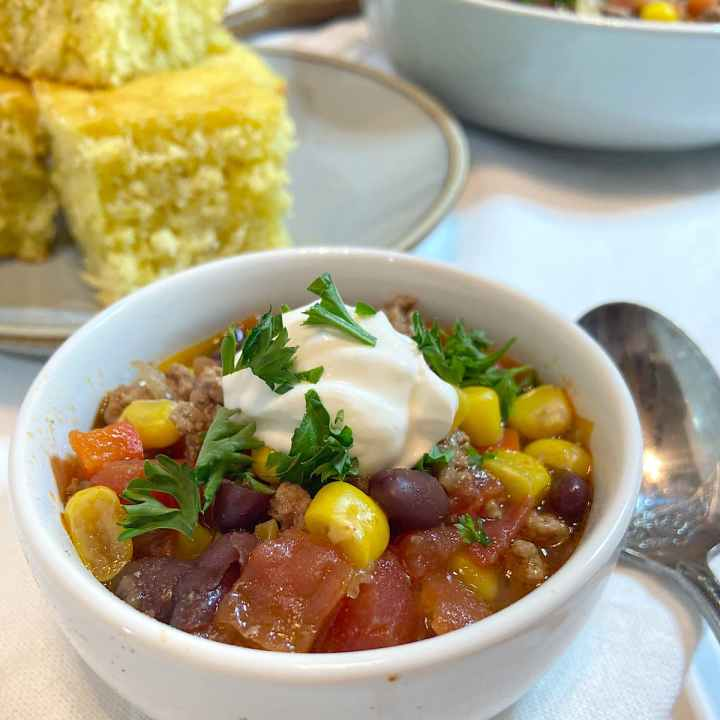 corn black bean and beef chili in bowl ready to eat