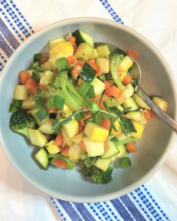 chopped marinated vegetable salad in bowl ready to serve