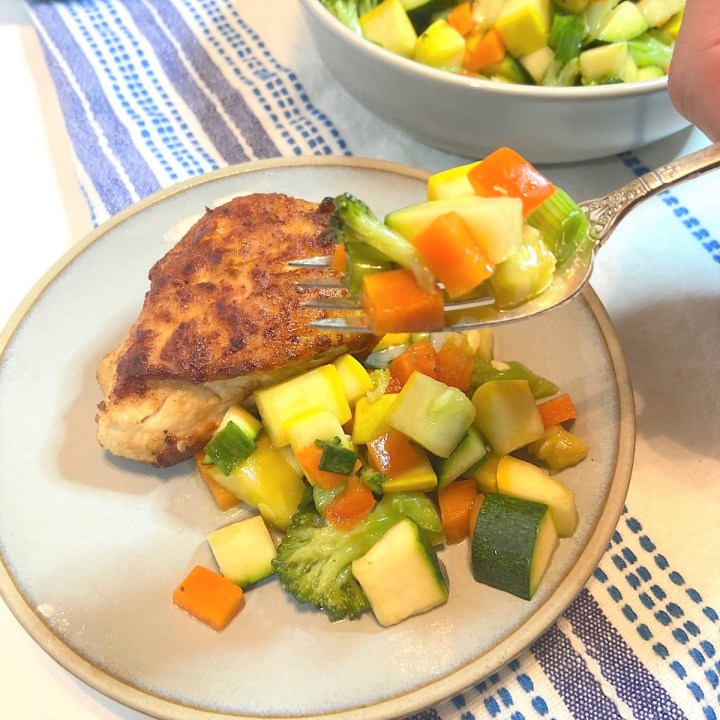 marinated vegetable salad with chicken on plate