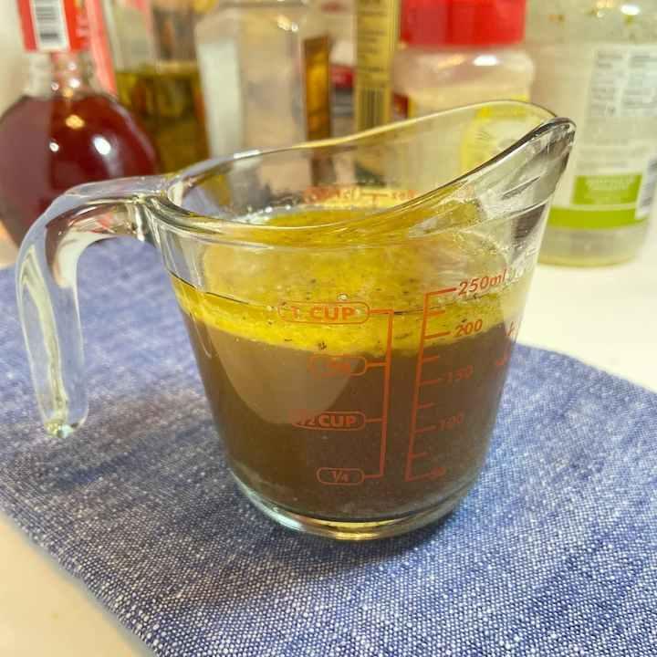 steak marinade in a measuring cup