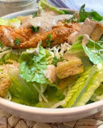 grilled chicken caesar salad in bowl