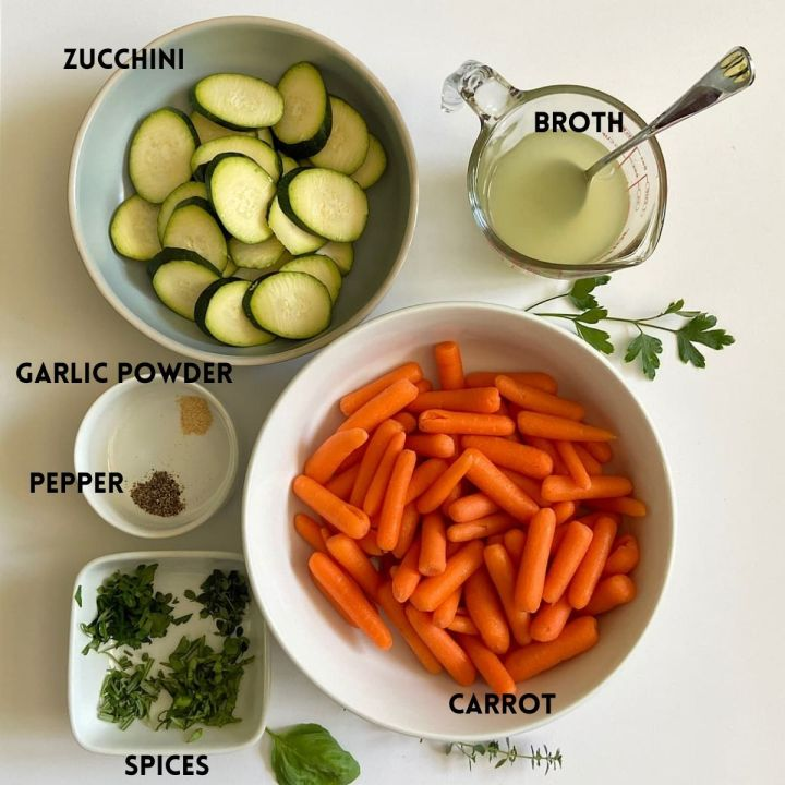 Measured ingredients for baby carrots with zucchini