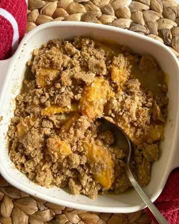 peach crisp in baking dish ready to serve
