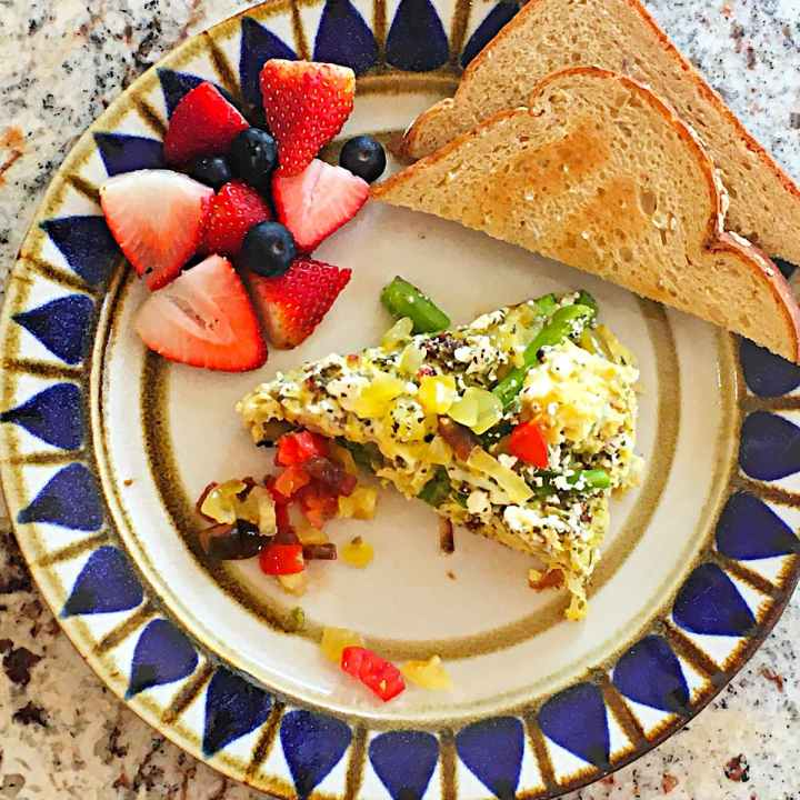 asparagus frittata, fruit and whole wheat toast on plate