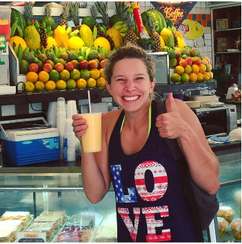 Whitney Small at a juice stand in Rio