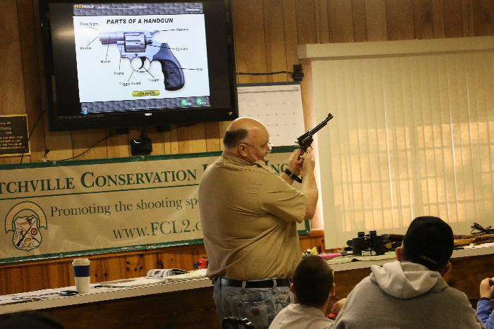 Paul demonstrates handguns