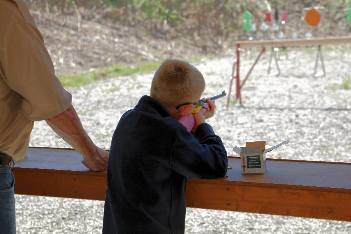 Student shooting a .22 rifle.