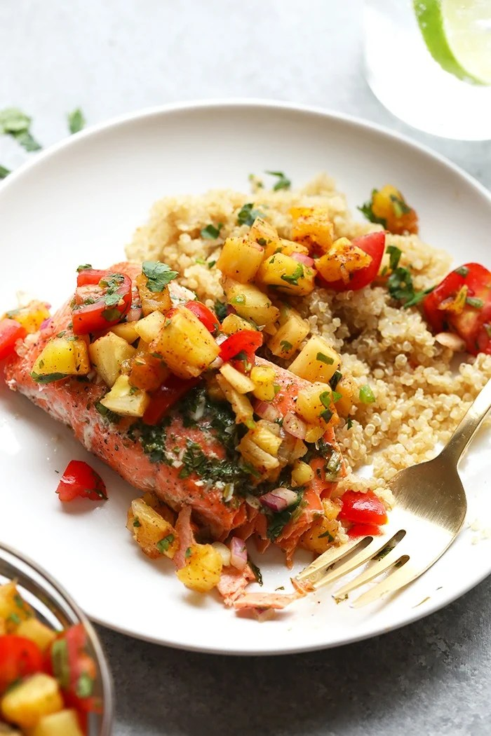Grilled salmon on a plate with pineapple salsa