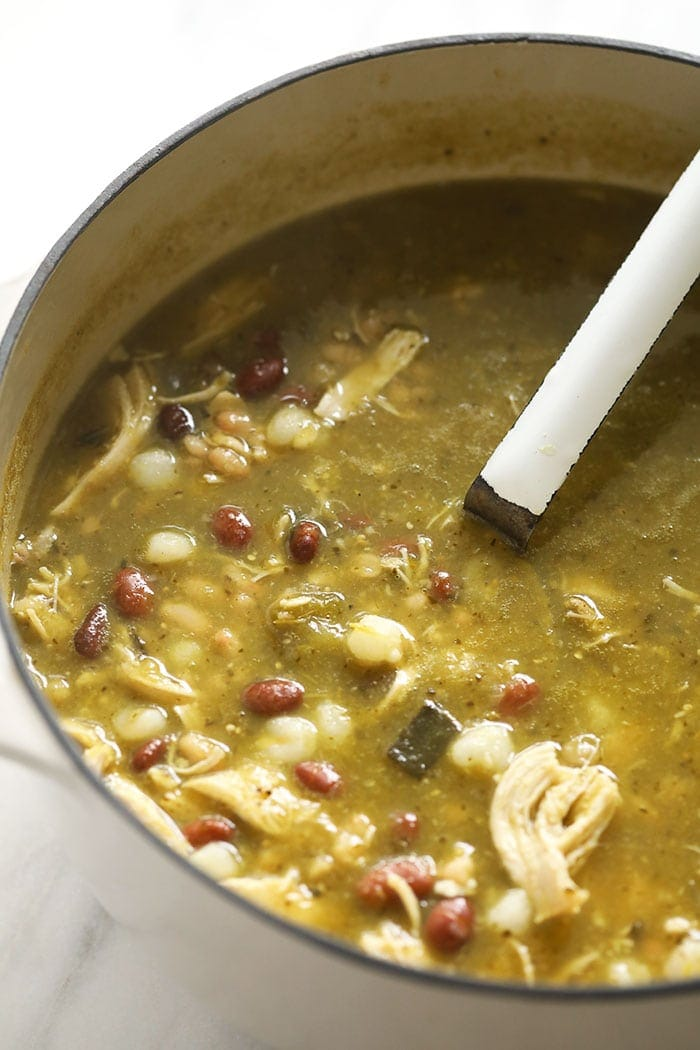 green chili in stock pot with ladle